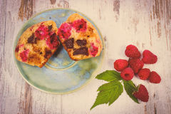 Vintage photo, Fresh baked muffins with chocolate and raspberries on wooden background, delicious dessert. Vintage photo, Homemade fresh baked muffins with Royalty Free Stock Photography