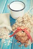 Vintage photo, Fresh baked oatmeal cookies, ingredients for baking and ears of oat, healthy dessert concept Royalty Free Stock Photos