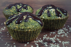Vintage photo, Fresh muffins with spinach, desiccated coconut and chocolate glaze, delicious healthy dessert Stock Images