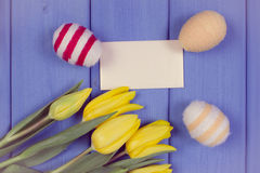 Vintage photo, Fresh tulips and Easter eggs wrapped woolen string, copy space for text on sheet of paper Stock Photo