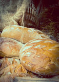 Vintage photo, Freshly baked traditional loaves of rye bread on stall Royalty Free Stock Images