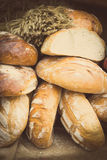 Vintage photo, Freshly baked traditional loaves of rye bread on stall Stock Photography
