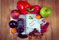 Vintage photo, Fruits and vegetables with glucometer and notebook for notes, healthy food, diabetes Royalty Free Stock Photography