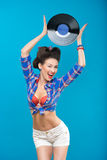 The vintage photo of girl holding vinyl record. Royalty Free Stock Image