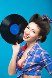 The vintage photo of girl holding vinyl record. Royalty Free Stock Photography