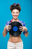 The vintage photo of girl holding vinyl record. Stock Image