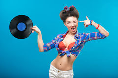 The vintage photo of girl holding vinyl record. Stock Images