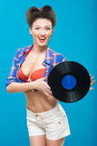 The vintage photo of girl holding vinyl record. Royalty Free Stock Photos