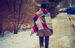 Vintage photo of girl walking by sidewalk at winter Royalty Free Stock Photos
