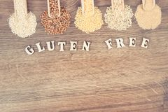 Vintage photo, Gluten free inscription with groats, amaranth, rice and quinoa seeds, copy space for text Stock Photo