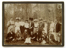 Vintage photo of the group of people in the forest Stock Photo