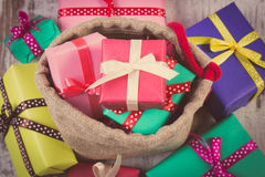 Vintage photo, Heap of wrapped gifts for Christmas or other celebration on old wooden plank Royalty Free Stock Photography