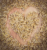 Vintage photo, Heart of oat grains, healthy nutrition, symbol of love Royalty Free Stock Photography