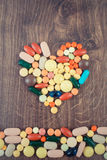 Vintage photo, Heart shaped colorful medical pills and capsules, health care concept Stock Images
