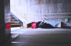 Vintage photo of homeless man rsleep in subway Royalty Free Stock Photo