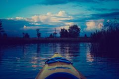 Vintage photo of kayaking by Krutynia river in Poland Royalty Free Stock Photography