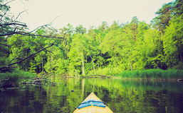 Vintage photo of kayaking by Krutynia river in Poland Stock Images