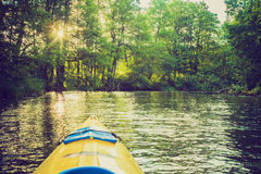 Vintage photo of kayaking by Krutynia river in Poland Royalty Free Stock Image