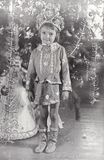 Vintage photo of little girl. Christmas and New Year party. Vintage photo of little girl near fir tree. Christmas and New Year party Stock Photography