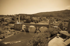 Vintage photo of medieval bridge over river Stock Image