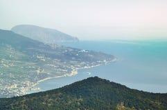 Vintage photo with mountains nad marine view. Vintage styled photo with mountains and hazy sea birds eye view. Travel to Yalta, Crimea, Ukraine (Black Sea Royalty Free Stock Photo