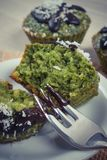 Vintage photo, Fresh muffins with spinach, desiccated coconut and chocolate glaze Royalty Free Stock Images