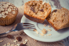 Vintage photo, Muffins with oatmeal baked with wholemeal flour on plate, delicious healthy dessert Royalty Free Stock Image