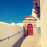 Vintage photo of narrow street in Lindos. Stock Photography
