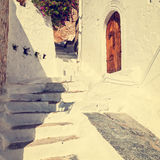 Vintage photo of narrow street in Lindos. Royalty Free Stock Image