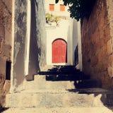 Vintage photo of narrow street in Lindos. Stock Photos