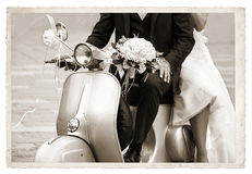 Vintage photo with newlywed. Vintage photo with Young newlywed just married, posing on an old gray scooter Royalty Free Stock Images