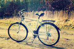 Vintage photo of  old bicycle on the grass Royalty Free Stock Photography
