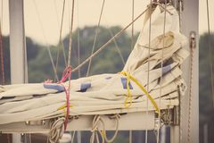Vintage photo, Parts and detail of sailboat in port of sailing. Vintage photo, Parts and detail of sail, sailboat or yacht in port of sailing Royalty Free Stock Image