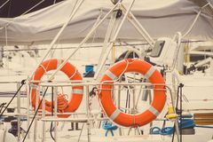 Vintage photo, Parts and detail of yacht, Orange lifebuoy on sailboat, safety travel concept. Vintage photo, Parts and detail of yachting, Orange lifebuoy on Royalty Free Stock Photo