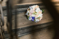 Vintage photo of pink and white wedding bouquet on wooden stairs Stock Photos