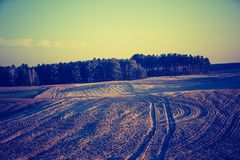 Vintage photo of plowed field in calm countryside Royalty Free Stock Images
