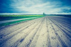 Vintage photo of plowed field in calm countryside Royalty Free Stock Photo