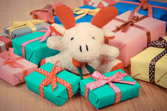 Vintage photo, Plush reindeer with colorful gifts for Christmas or other celebration Stock Images