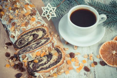 Vintage photo, Poppy seeds cake, cup of coffee and spruce branches, dessert for Christmas Royalty Free Stock Photos