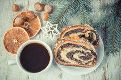 Vintage photo, Poppy seeds cake, cup of coffee and spruce branches, dessert for Christmas Royalty Free Stock Images