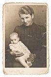 Vintage photo portrait of mother with baby wearing vintage cloth Royalty Free Stock Photography