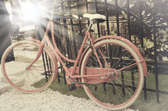 Vintage photo of red bicycle Royalty Free Stock Photography