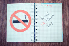 Vintage photo, Red no smoking sign, world no tobacco day in notebook Stock Image
