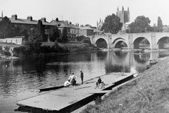 Vintage Photo 1897 River Wye and Cathedral, Hereford. Vintage Photo 1897 of River Wye with children on floating jetty, boat and bridge with Cathedral in Royalty Free Stock Photos