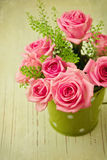 Vintage photo of rose flower bouquet. On wood table stock photography