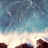 Vintage photo sea landscape, wave and rocks Stock Image