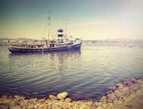 Vintage photo of ship wreck in harbour. Royalty Free Stock Photography