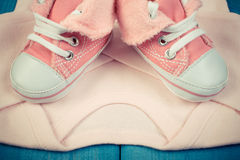 Vintage photo, Shoes and bodysuits for newborn, expecting for baby Royalty Free Stock Photos
