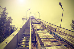Vintage photo of ski jump facility. Royalty Free Stock Image