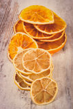 Vintage photo, Slices of dried lemon and orange on old wooden background Royalty Free Stock Photo